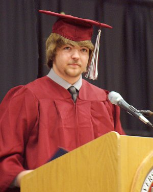 Gentry senior Joe Savage serves as master of ceremonies during Gentry's graduation exercise Monday.
