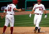 Arkansas Democrat-Gazette/JASON IVESTER - 05/21/11 - Arkansas' Collin Kuhn is congratulated by teammate Bo Bigham after hitting a two-run home run which scored the pair in the third inning against Ole Miss during the second game on Saturday, May 21, 2011, at Baum Stadium in Fayetteville.