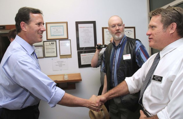 file-in-this-may-31-2011-file-photo-former-pennsylvania-sen-rick-santorum-left-shakes-hands-with-new-hampshire-state-rep-thomas-howard-before-touring-rugar-firearms-in-newport-nh-santorum-is-set-to-formally-announce-on-monday-june-6-2011-he-is-seeking-the-republican-partys-presidential-nomination