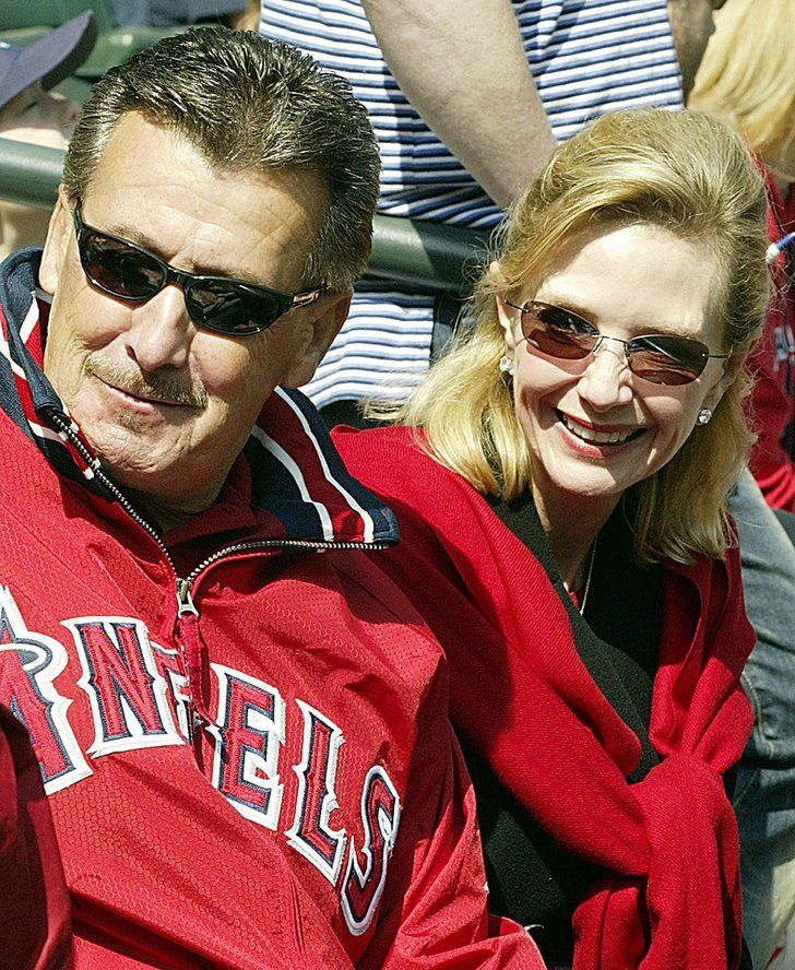 Anaheim Angels owner Arte Moreno and his wife Carole sit ...