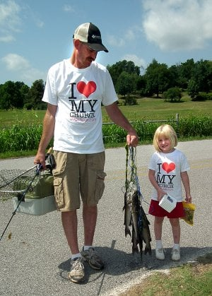 Kayla Philpott, 4, and her dad, David Philpott, took their catch back to weigh in. Kayla was the overall winner for ages 1-7 with a 3.9 pound stringer.