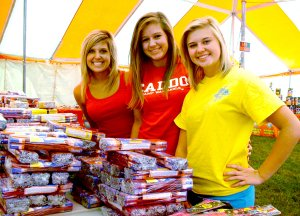 Blackhawk cheerleaders Morganne Rhine, Samantha Truesdell and Heather Patton worked the cheerleaders' fundraising fireworks stand recently. The stand, on Slack Street just east of It'll Do Road, is one of the major fundraising projects for the cheerleaders.