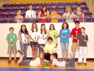 Pictured are first-place winners at the Ozark District 4-H O'Rama Competition Day. On the floor are: Janeé Shofner, Sayer Smith, and Kendall Yarbrough. Row two: Ty Connolly, Samantha Brandeberry, Samantha Lambert, Sarah Mills, Carley Goggans, Casey Jarding, Noah Smith and Ethan Parker. Top: Alex Joyce, Adriana Joyce, Jessica Romines, Mitchell Baker, Ashton Yarbrough, Holly Holmes-Smith.