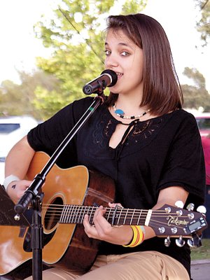 Meagan White plays on the stage in Gentry at a Fall Festival.