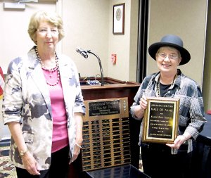 Gravette author, Radine Trees Nehring, shown on the right, accepted a plaque honoring her induction into the Arkansas Writers' Hall of Fame. Making the presentation was author and writing teacher Marilyn Collins.