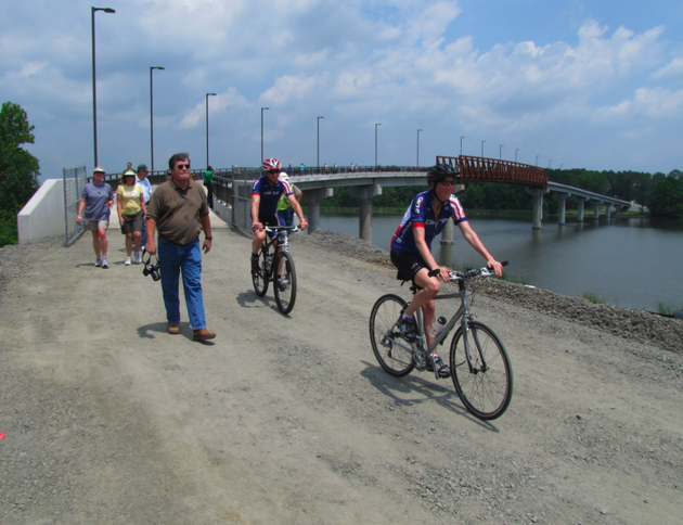 bicyclists-and-pedestrians-try-out-the-new-two-rivers-park-bridge-shortly-after-a-dedication-ceremony-friday