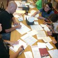 Volunteers from the Benonville School District write thank you notes Thursday, July 14, 2011, at Jop...