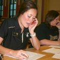Jaclyn Evans, left, and Shawn Quinlan, both teachers with the Bentonville School District, call Jopl...