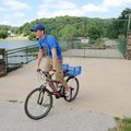 Clay Eliasen, 14, from Bentonville makes a 180 degree turn at the closed road over the dam while rid...