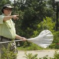 Robert Thomas, of Fayetteville, talks Saturday, July 16, 2011, points out a dragonfly during a progr...