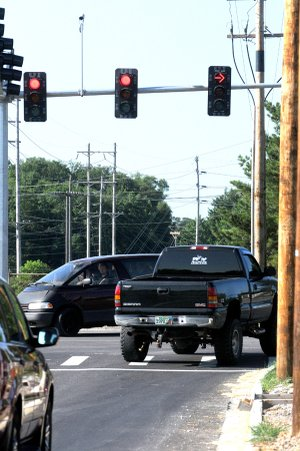 A Truck Turns Right Tuesday On A Solid Red Arrow From Elm Tree Road To  Southwest