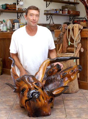 From a tree stump and roots to a work of art, Curtis McChristian sees possibilities others miss and brings out scenes and characters from nature and of the Old West and the days of cattle drives.