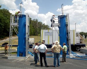 More than 30 people from the Arkansas Department of Environmental Quality, engineering firms and local municipalities toured the pilot Blue PRO filter set up at the Decatur Wastewater Treatment Plant. Many climbed the 18-foot-tall tanks for a peek inside and also walked through the trailer to view how the controls and monitors worked.
