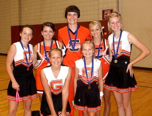 "Gravette All-American cheerleaders, back row, Taylor Eaton, Kayla Holliday, ""Leo the Lion"" Sayer Smith, Candace Pembleton and Meghan McAfee. Front row, A.J. Clabon and Micayla Hendricks."