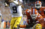 LSU quarterback Jordan Jefferson (9) runs past the Florida's  Duke Lemmens (44) for a 1-yard touchdown during the first half of an NCAA college football game in Gainesville, Fla., Saturday, Oct. 9, 2010.