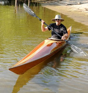 "Doug Powell's hybrid boat hits the water for the first time at the town of Beaver on the White River. He built the kayak using the ""stitch and glue"" method and a strip planking process."