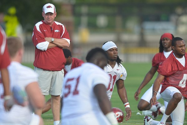 University of Arkansas coach Boby Petrino watches his team run drills during the newcomers practice Thursday afternoon in Fayetteville.