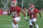 University of Arkansas receiver Greg Childs (left) and MArquel Wade runs drills during the newcomers practice Thursday afternoon in Fayetteville.