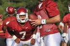 University of Arkansas quarterback Tyler Wilson and runningback Knile Davis run drills during the Razorbacks practice Friday evening in Fayetteville.