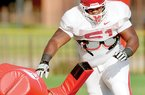 University of Arkansas Razorbacks defensive tackle Alfred Davis runs drills during practice Monday afternoon on the intramural fields at the University of Arkansas in Fayetteville.