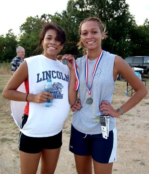 Sara and Mara Harris displayed their medals after winning second and first place, respectively, in the 2K Race.