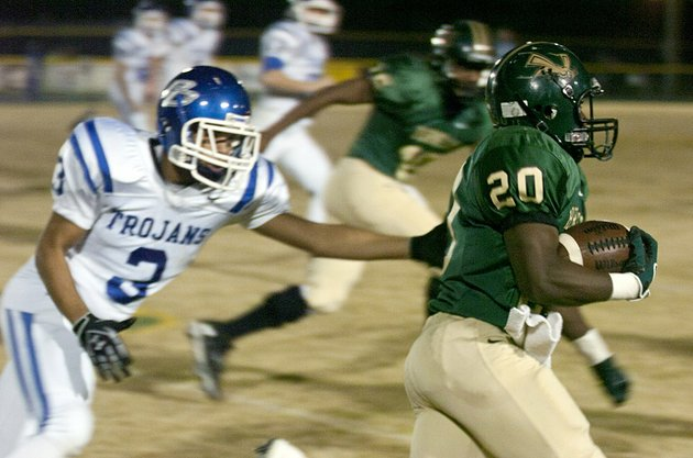 staff-photo-by-eric-j-shelton-mineral-springs-high-schools-running-back-rashad-williams-dodges-a-trojan-defender-during-their-game-friday-night-at-hornet-stadium