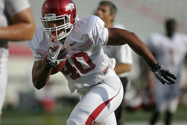 Arkansas freshman running backs Kody Walker (above) and Kelvin Fisher (below) are getting more work with the Razorbacks offense after the season-ending injury sustained by Knile Davis, last season's leading rusher.
