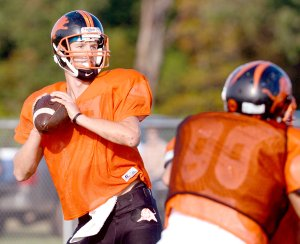 Clayton Alexander drops back to pass during the Gravette Lions' scrimmage on Saturday.