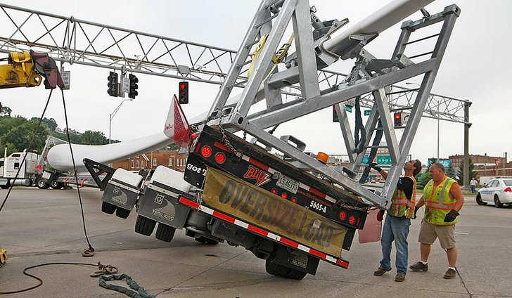 Towing Crews Work To Clear An Accident Involving A Truck