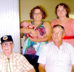 Present for the annual Payne Family reunion at the Gravette picnic are five generations pictured: Seated, from the left, is Delbert O'Neal (brother of Leota Payne) and his nephew Bill Payne. Great-great niece Nikki Mayer is holding Kylee Campbell, great-great-great niece. On the right is great-great niece Paula Nicholson.