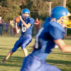 Bulldog quarterback Evan Owens threw a pass during the scrimmage game between Decatur and Berryville on Thursday.