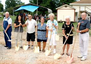 Breaking ground for a new 150-by-60-foot Care and Share building in Gravette were, from the left, Keith Boldt, Brenda Yates, Bo Roberts representing his father Marion Roberts, Vicki Hearne, Virginia Todd, Sandy Bugner and Bill Bugner.