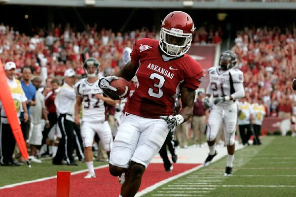 Arkansas punt returner Joe Adams coasts into the end zone on a 61-yard first-quarter punt return that gave the Razorbacks a 14-0 lead on the way to a 51-7 victory over Missouri State on Saturday at Reynolds Razorback Stadium in Fayetteville. Adams also scored on a 69-yard punt return in the third quarter, making him one of three Razorbacks to score two punt-return touchdowns in a single game.