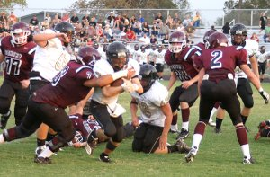Gentry senior Ricky Hernandez puts an end to a West Fork run attempt during a scrimmage in Gentry on Aug. 23.