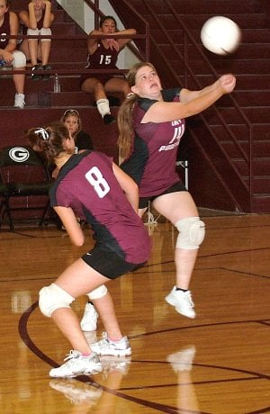Gentry senior Sarah Tisdale keeps a ball from dropping into the back court in recent play against Lincoln at Gentry High School. Though the girls won all three games against Lincoln, they lost to Southwest City (Mo.) 25-19, 10-25, 13-25, 21-25 on Aug. 29.