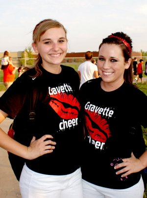Lion Pride Night — Gravette Lion Cheerleaders Dallas Banta and Makalyn Hurtt show how proud they are to be Lion boosters. The recent Pride Night at Gravette High School drew a huge crowd of Lion supporters. There were scrimmages, good food, band music, introduction of players and, as this photo shows, relaxation and fun for all.