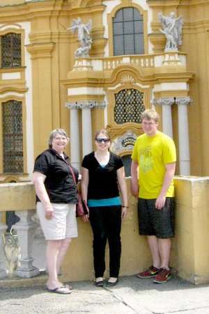 Magdalena Riedler center with Karen Kerr and her grandson, Jeremy McGarrah in front of a castle of the Hapsburg family in Vienna.