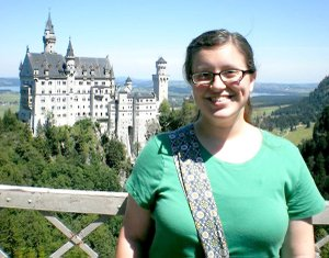 "Erica Leeman, visiting in Germany, is shown standing in the foreground of Castle Neuschwannstein, which she described as Germany's ""most famous castle."""