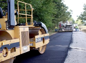 The paving crew of the Benton County Road Department last week completed laying a 2-inch layer of hotmix asphalt on Lime Kiln Road in Gravette.