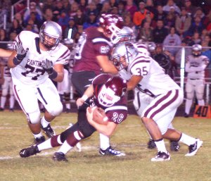 Gentry senior Tanner Coy breaks through the line and picks up a few yards for Gentry on Friday.