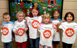 Students at Glenn Duffy Elementary School in Gravette were awarded PAWS T-shirts for September.
