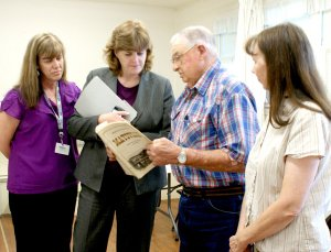 Diane Tindale, second from left, discusses the Maysville P.O. closing with former Maysville Postmaster Marvin Wilber, while postmaster Kim Smith, left, and Martha Tucker look on.