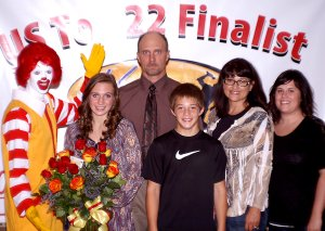 Kaylin Cripps (next to Ronald McDonald), a senior at Gentry High School and an employee of the new McDonalds Restaurant in Gentry, won the McDonalds Greater Southwest Region Voice of McDonalds Singing Contest and was told she had won in a special surprise ceremony at her school on Wednesday (Sept. 21, 2011). Pictured with Kaylin are her father, Eldon Cripps; her mother, Kaye Cripps; her younger brother, Cole Cripps; and her sister, Tahmara Coones.
