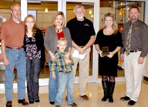 Pictured, in the center, are Beth Johnson and her son Zane. On her right are father Jared Johnson and big sister Victoria, Keith Vire, the honoree Ashley Casey, and elementary principal Zane Vanderpool.