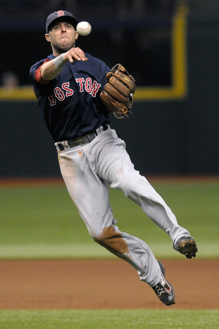 boston red sox second baseman dustin pedroia throws out