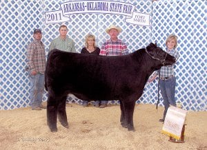 Haley House of Gravette showing her Reserve Grand Champion Steer