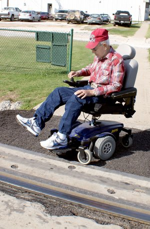 The KCS railroad crossing stymies Joe Pritchard who is wheelchair bound and denies him access to the east side of Gravette.