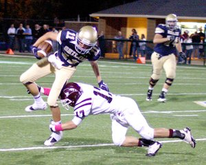 Gentry senior Jordan Cousins puts an end to a run by Shiloh Christian Friday night in Springdale.