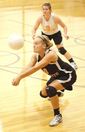 Gravette senior Shyanne Nichols digs to set up the ball during play against Gentry on Thursday at Gentry.