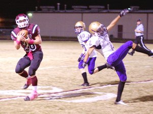 Gentry senior Tanner Coy gets behind Berryville defenders and pulls in an Ochs pass during play on Friday.